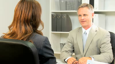 stock-footage-caucasian-stock-broker-concluding-meeting-with-female-client